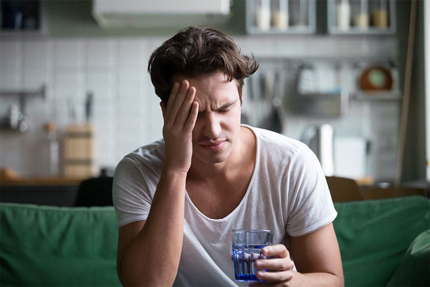 man suffering from morning headache