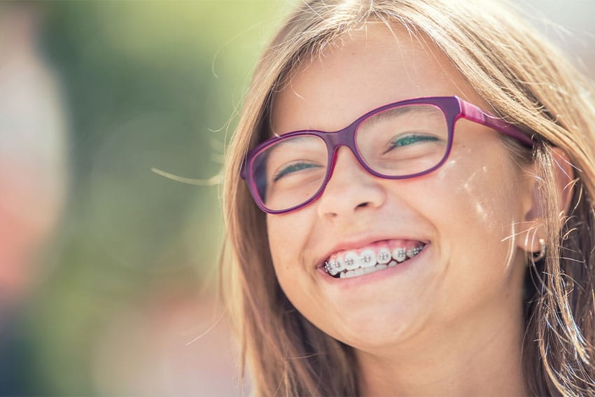young girl with happy smile with braces
