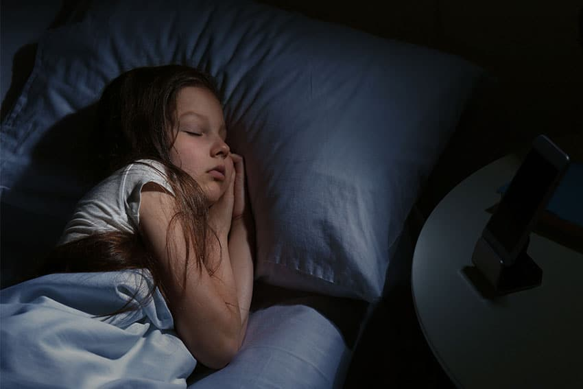 young child resting peacefully in bed