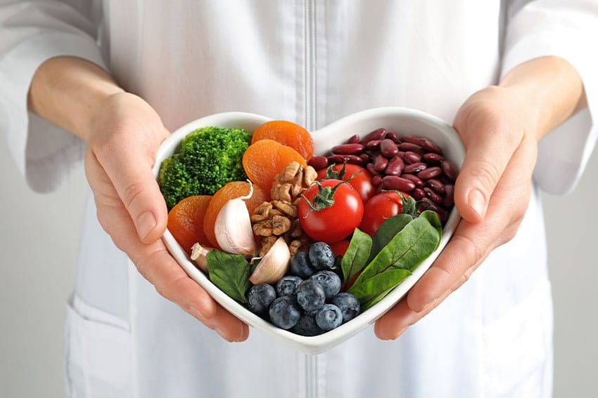 heart shaped bowl of healthy foods